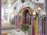 kandelabry ze świecami i dekoracjami wielkanocnymi, dekoracje eventowe, dekoracje wielkanocne dla PGNIG